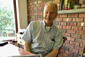 Solar boat designer David Borton at home in Brunswick with a map of the Inside Passage.