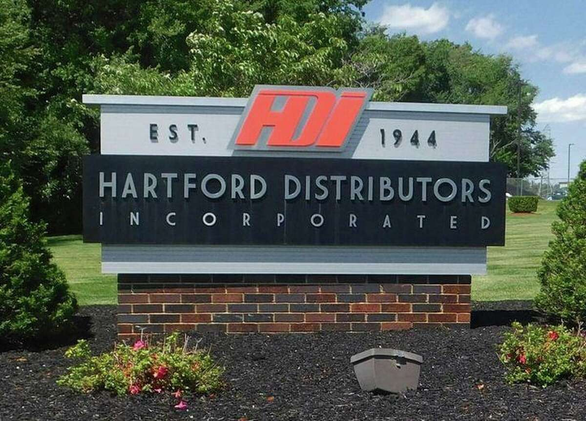 A sign for Hartford Distributors Inc. in Manchester, Conn., where eight people were shot dead and two others wounded on Aug. 3, 2010.