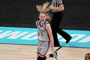 UConn guard Paige Bueckers (5) celebrates a score against Baylor during the first half of a college basketball game in the Elite Eight round of the women's NCAA tournament at the Alamodome in San Antonio, Monday, March 29, 2021. (AP Photo/Eric Gay)