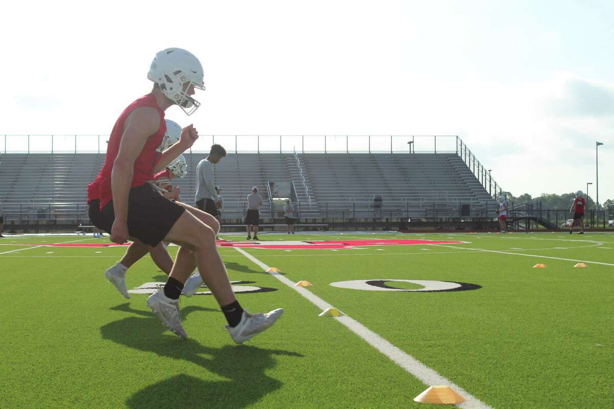 Gunnner Gates going through footwork drills on the first day of fall camp at Falcons Stadium on Monday.