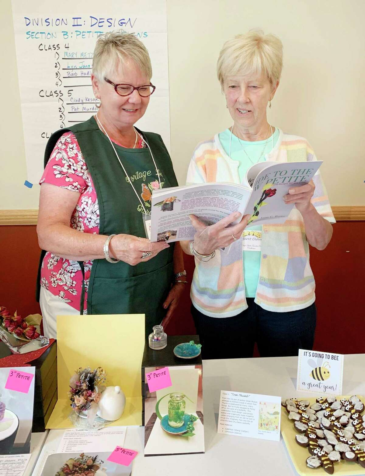 Portage Lake Garden Clubmembers LaVonne Beebe and Margaret Cloutier discuss entering the Petite Design section of the Design Division for theclub's 2022 Flower Show. (Courtesy photo/Elaine Maylen)