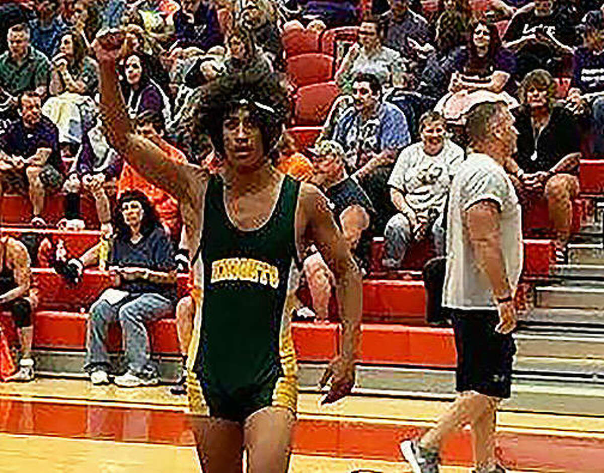 Metro-East Lutheran wrestler Elijah Schlessinger celebrates a first-round victory in the Class 1A Lawrenceville Sectional.
