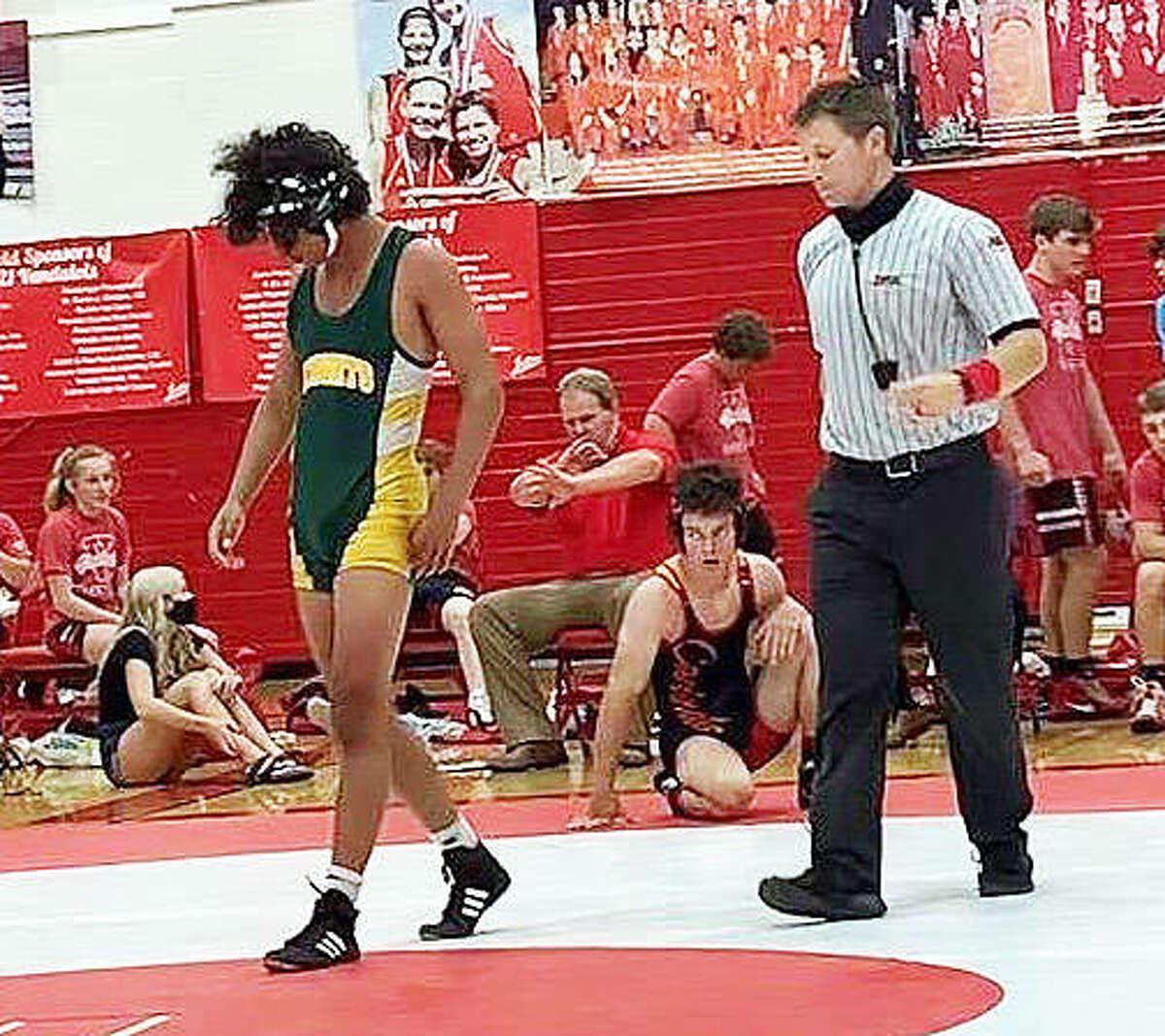 Metro-East Lutheran wrestler Elijah Schlessinger walks off the mat after a regular-season victory at Vandalia.