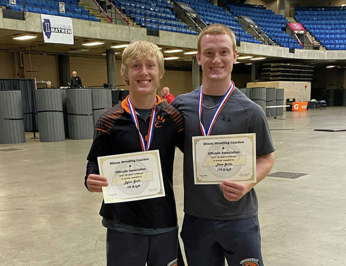 Edwardsville High School's Dylan Gvillo, left, and Drew Gvillo pose with their All-State certificates after the finish of the IWCOA Class 3A state wrestling tournament in Springfield.
