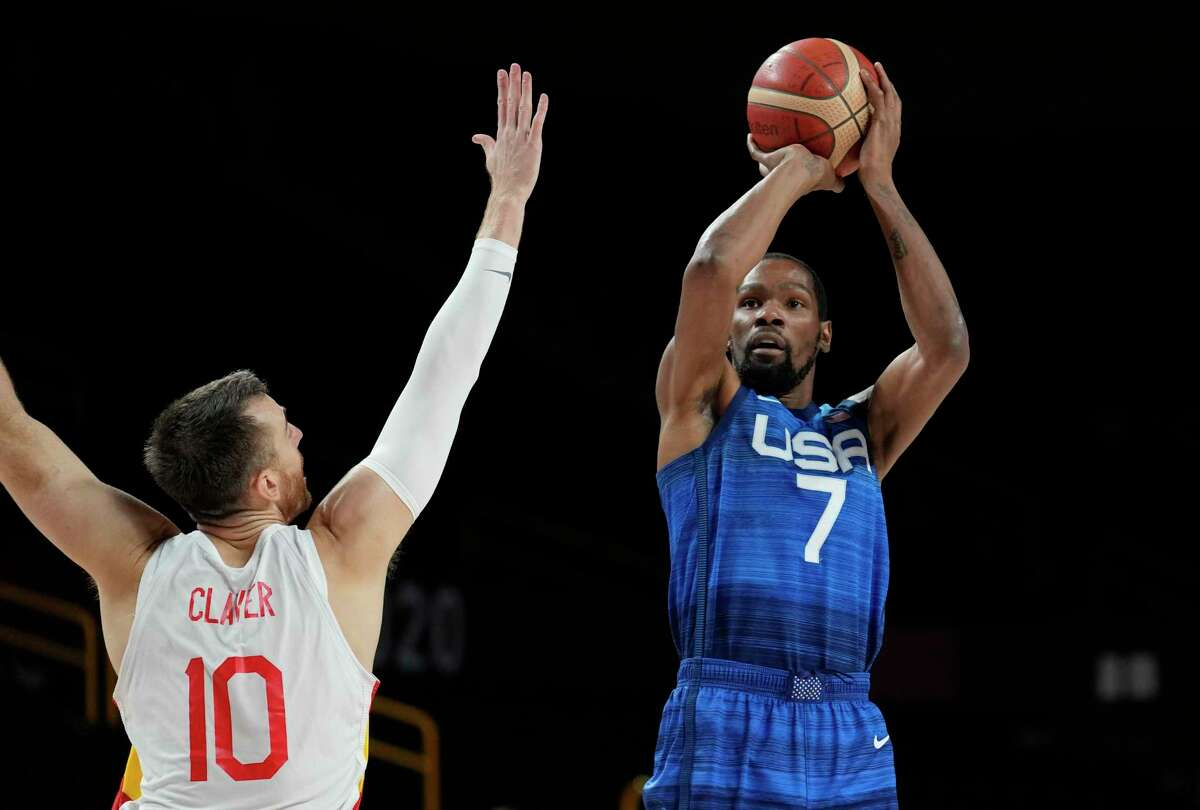 United States' Kevin Durant (7), right, shoots over Spain's Victor Claver (10) during men's basketball quarterfinal game at the 2020 Summer Olympics, Tuesday, Aug. 3, 2021, in Saitama, Japan. (AP Photo/Eric Gay)