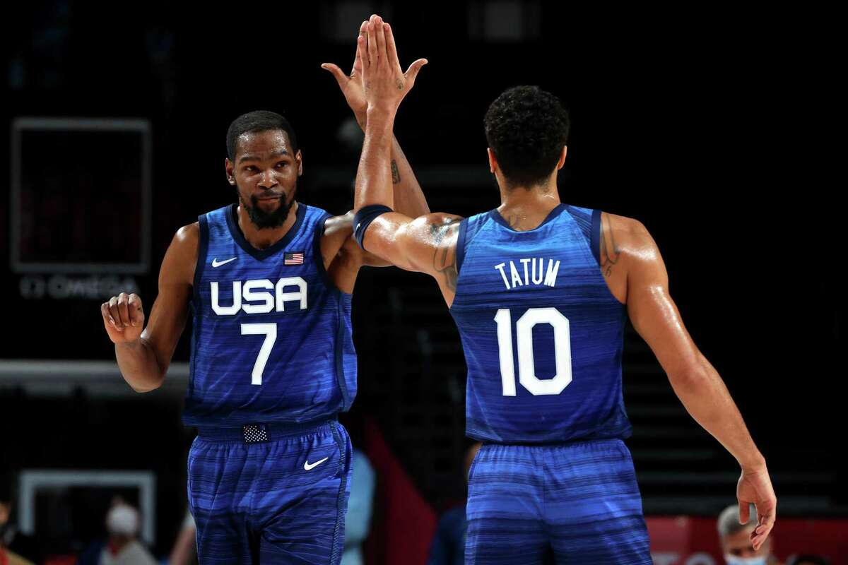 SAITAMA, JAPAN - AUGUST 03: Kevin Durant #7 and Devin Booker #15 of Team United States celebrate a win against Spain following a Men's Basketball Quarterfinal game on day eleven of the Tokyo 2020 Olympic Games at Saitama Super Arena on August 03, 2021 in Saitama, Japan. (Photo by Kevin C. Cox/Getty Images)
