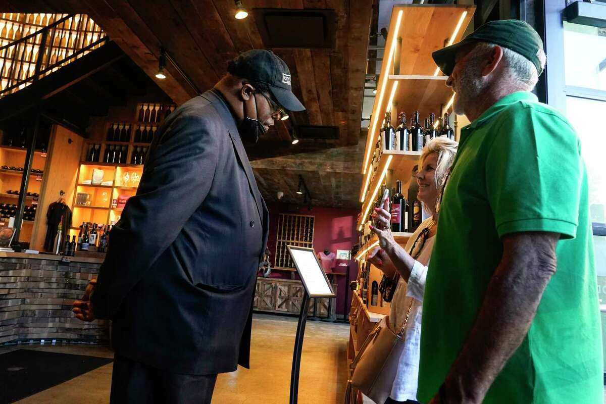 Security personnel ask customers for proof of vaccination as they enter City Winery on June 24, 2021, in New York.