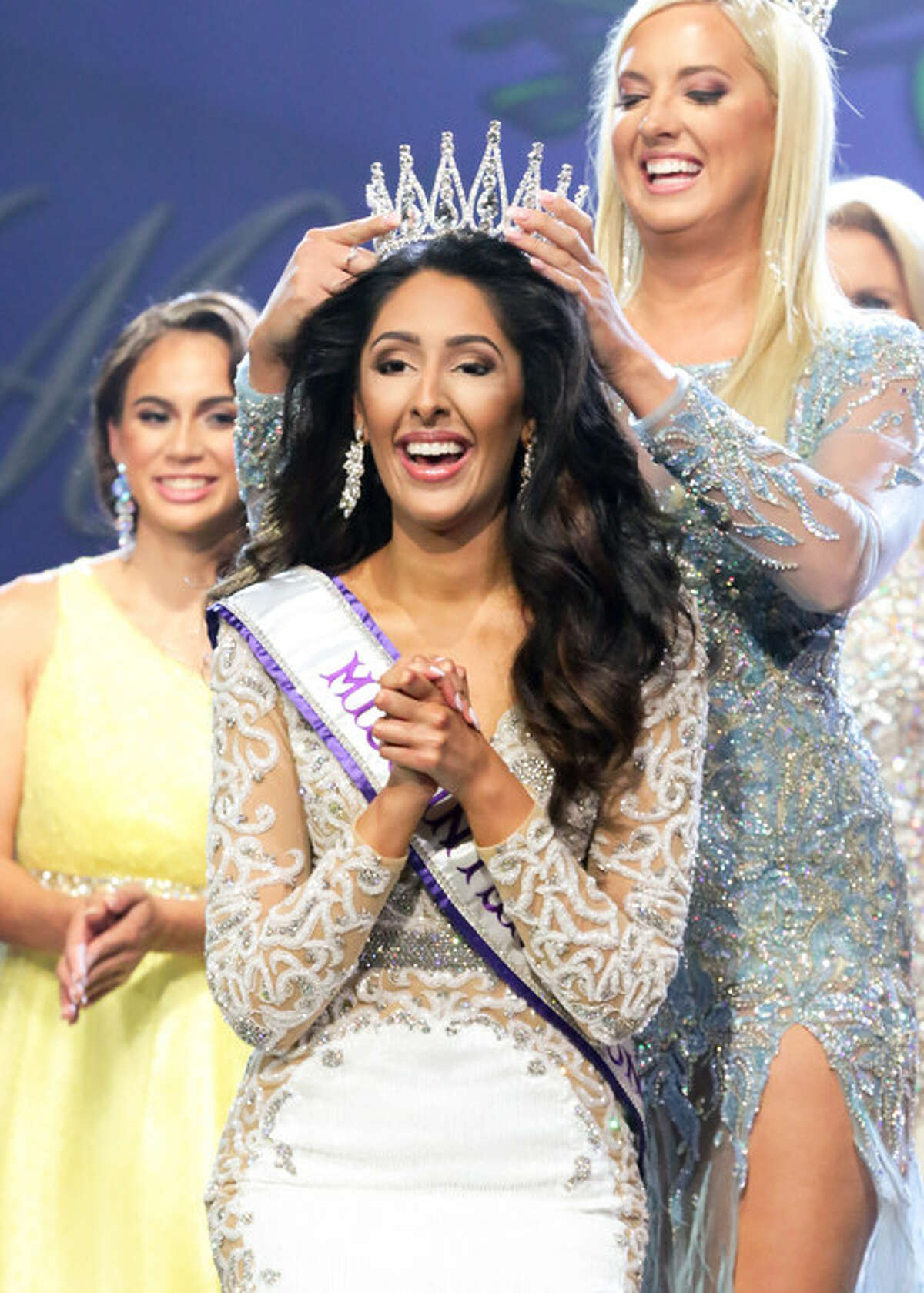 Miss International 2021, Deepa Dhillon, of Huntley, Ill., is crowned by Miss International 2020, Megan Vladic, during the annual final competition held July 31 in Kingsport, Tennessee. Photo credit: Paul Preston Photographer (PRNewsfoto/International Pageants, Inc.)