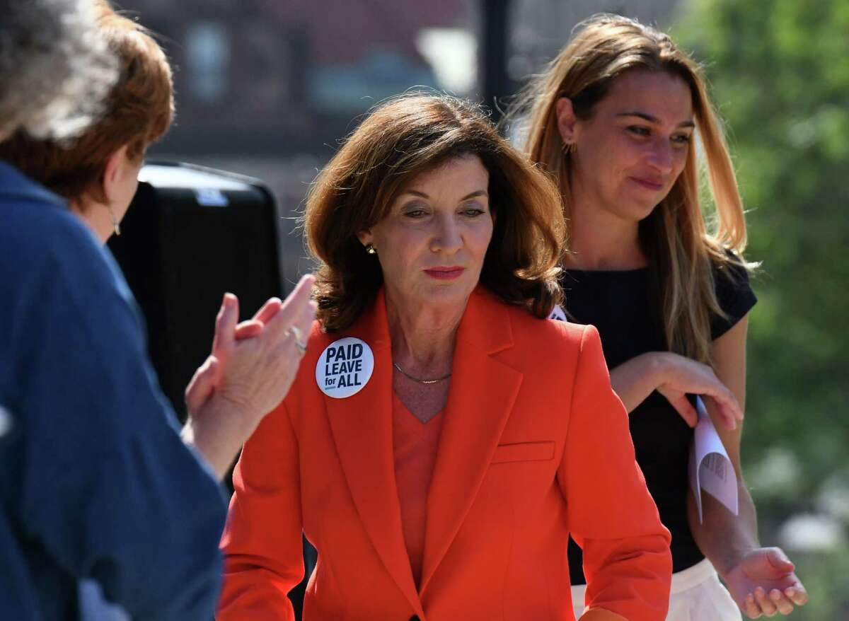 Lt. Gov. Kathy Hochul, right, joins advocates for paid family and medical leave for all working people during a stop on the Paid Leave for All's national bus tour on Tuesday, Aug. 3, 2021, outside the Capitol on Washington Avenue in Albany N.Y. The campaign is leading a cross-country bus tour visiting 14 cities around the United States to call on lawmakers to pass a national paid leave policy as part of the next infrastructure package.
