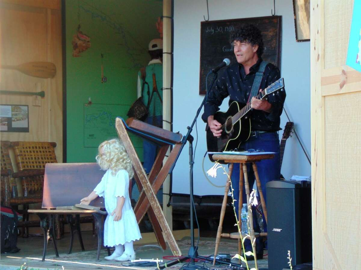 Folk artist Chris Vallillo presented songs of the one-room schoolhouse days. (Star photo/Shanna Avery)