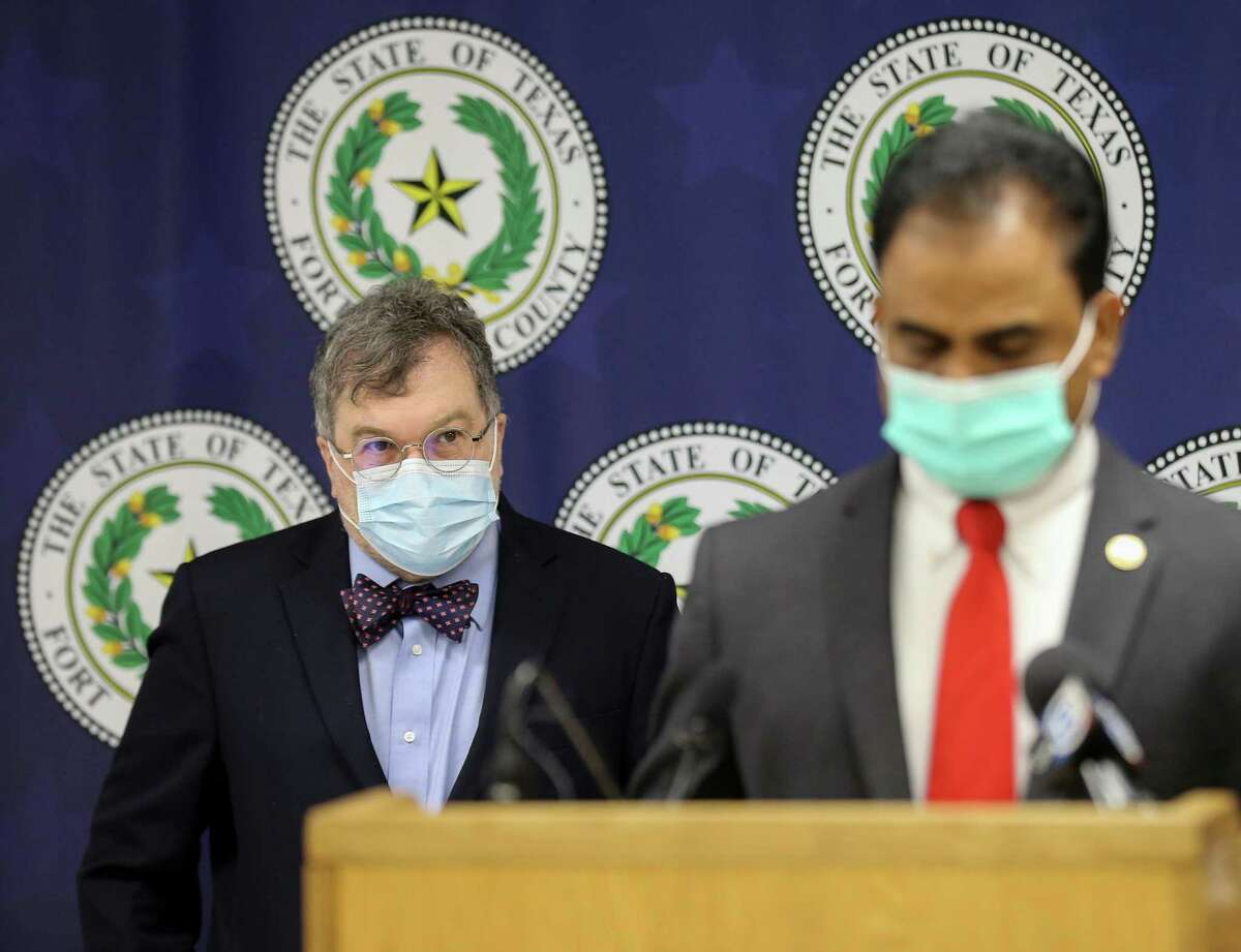 Co-director of the Center for Vaccine Development at Texas Children's Hospital Dr. Peter Hotez, left, looks at Fort Bend County Judge KP George who talked to reporters during a press conference about the COVID-19 risk level for the county being increased on Tuesday, Aug. 3, 2021, in Richmond.
