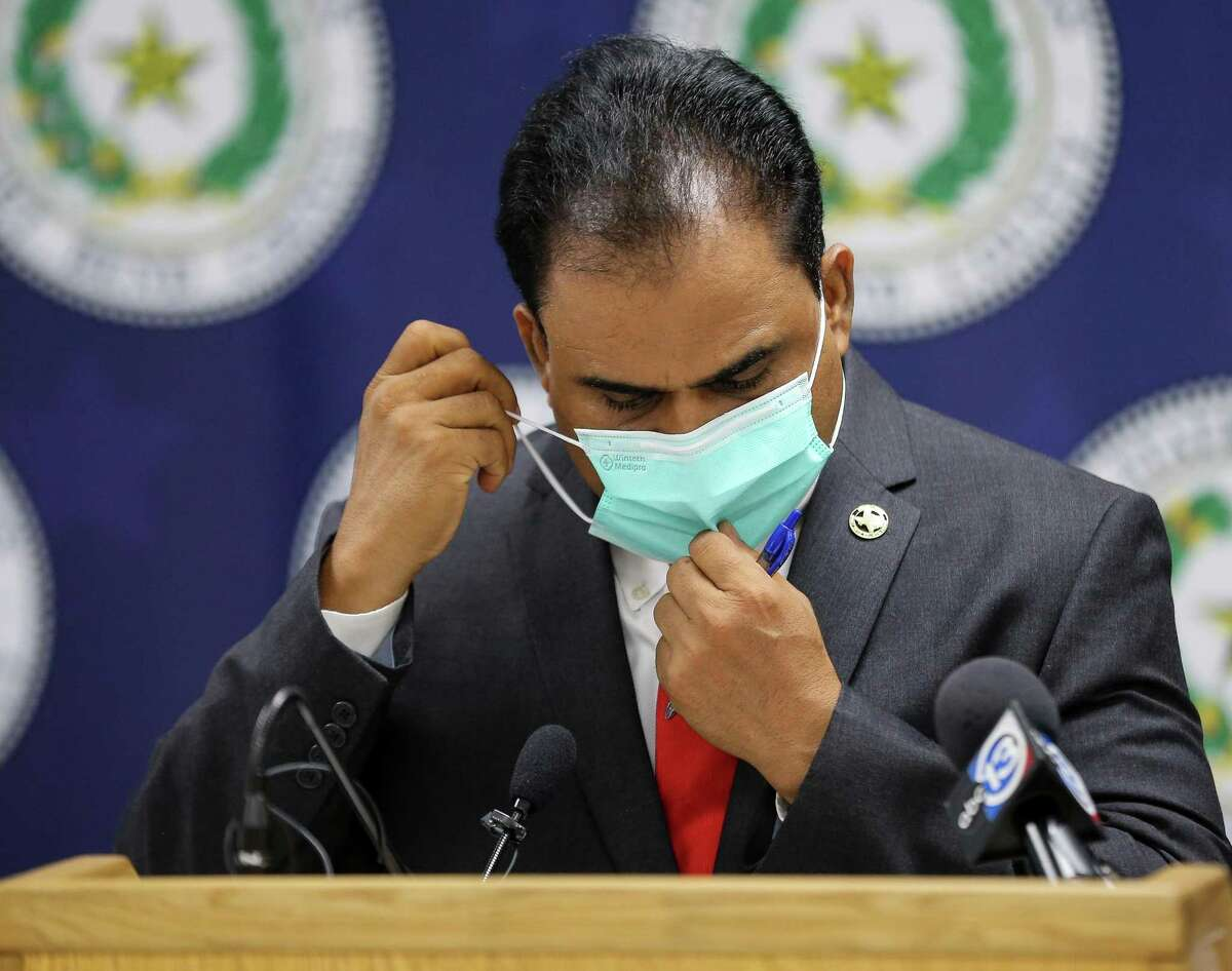 Fort Bend County Judge KP George puts his face mask back on after he talked to reporters at a press conference in which he indicated the COVID-19 risk level has been increased for the county on Tuesday, Aug. 3, 2021, in Richmond.
