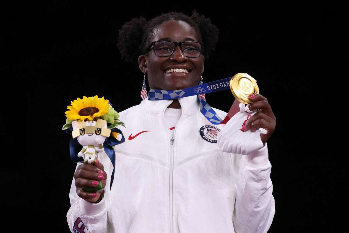 Gold medalist USA's Tamyra Marianna Stock Mensah poses with her medal after the women's freestyle 68kg wrestling competition of the Tokyo 2020 Olympic Games at the Makuhari Messe in Tokyo on August 3, 2021.