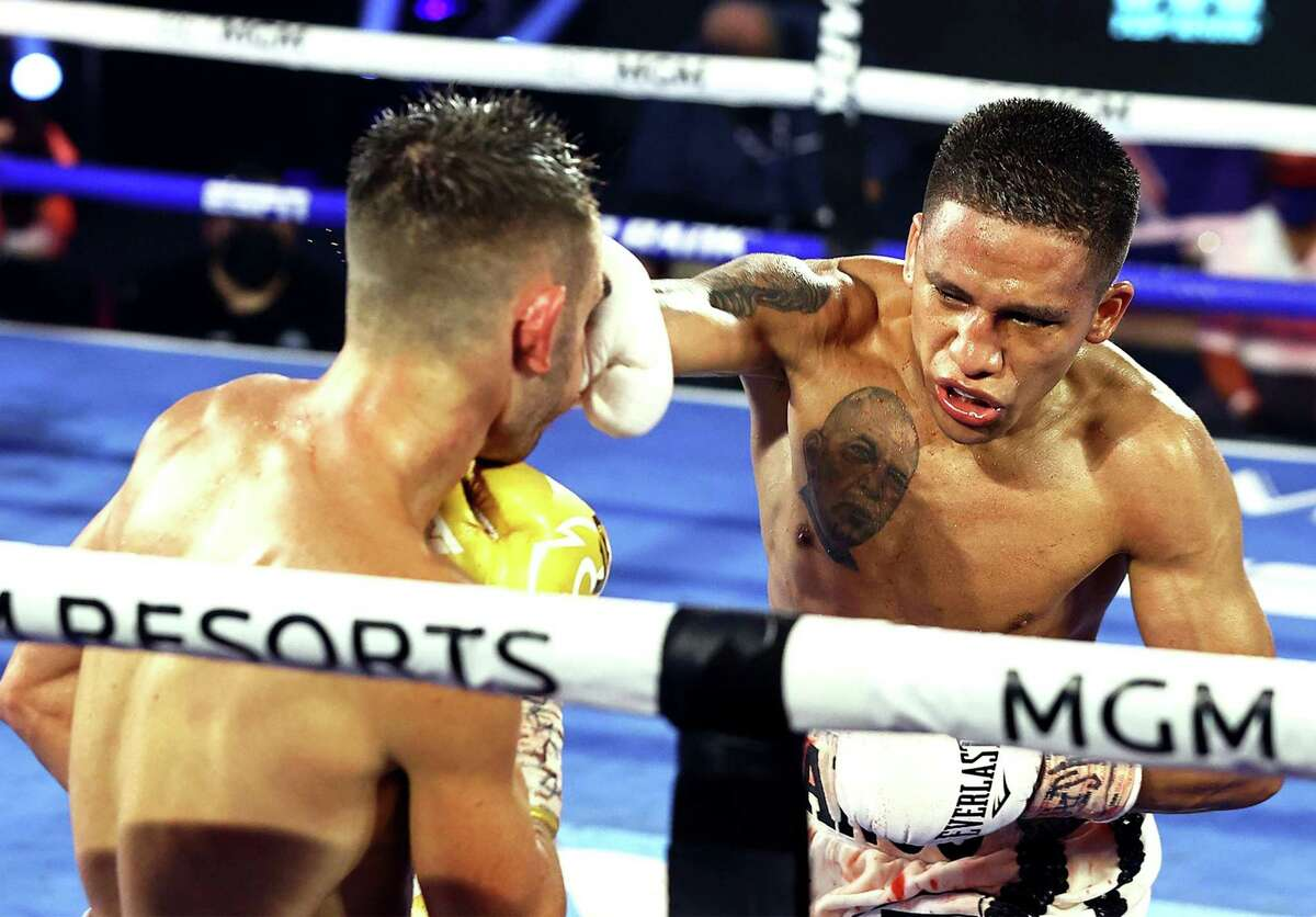 LAS VEGAS, NEVADA - JUNE 23: In this handout image provided by Top Rank, Joshua Franco punches Andrew Moloney during their WBA Super-Flyweight World Title fight at MGM Grand Conference Center Grand Ballroom on June 23, 2020 in Las Vegas, Nevada. (Photo by Mikey Williams/Top Rank via Getty Images)