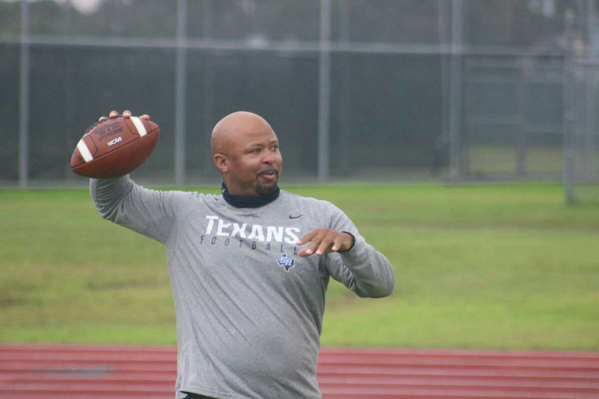 Sam Rayburn head football coach Demond Stafford works with his quarterbacks during a Tuesday morning practice.