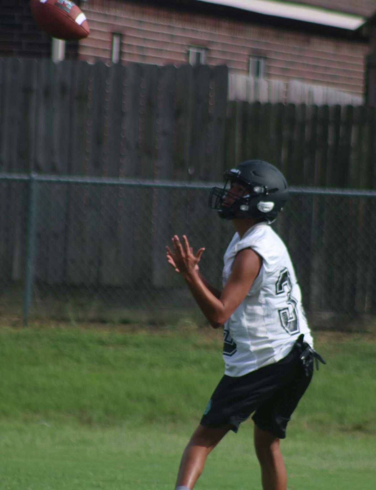 Pasadena Memorial High School's Ethan Munoz prepares to haul in a pass during a Monday evening practice. The Mavs are knocking on the door to the program's 90th victory since the program began in 2004.