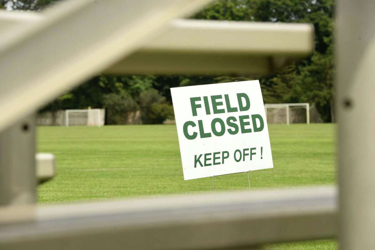 Signs are placed in many locations to keep off the soccer fields at Clifton Commons on Tuesday, Aug. 3, 2021 in Troy N.Y.