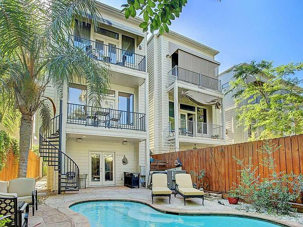 Two balconies overlook the pool.