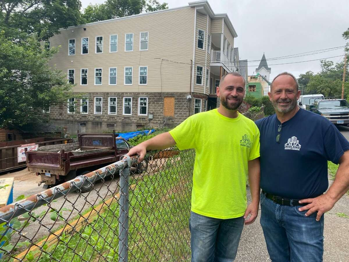Don Stanziale Jr., and his son, Don III, owners of Midland Development & Contracting, in front of Coram Avenue properties - one they are renovating, the other a vacant lot that could soon become apartments.