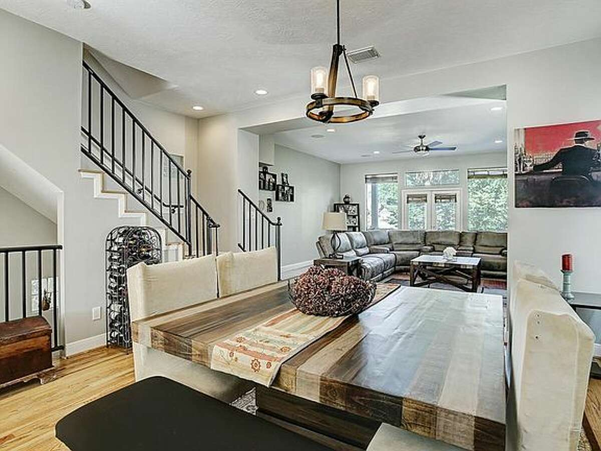 The dining area leads into a large living room.