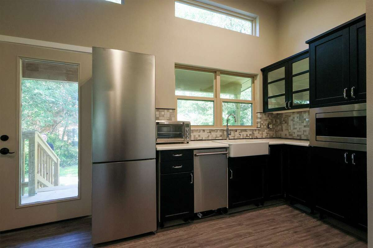 In an effort to save space, the kitchen dishwasher and refrigerator are narrower than appliances typically found in the United States, 17 inches and 23 inches, respectively. They also installed a single unit combination washer and dryer.