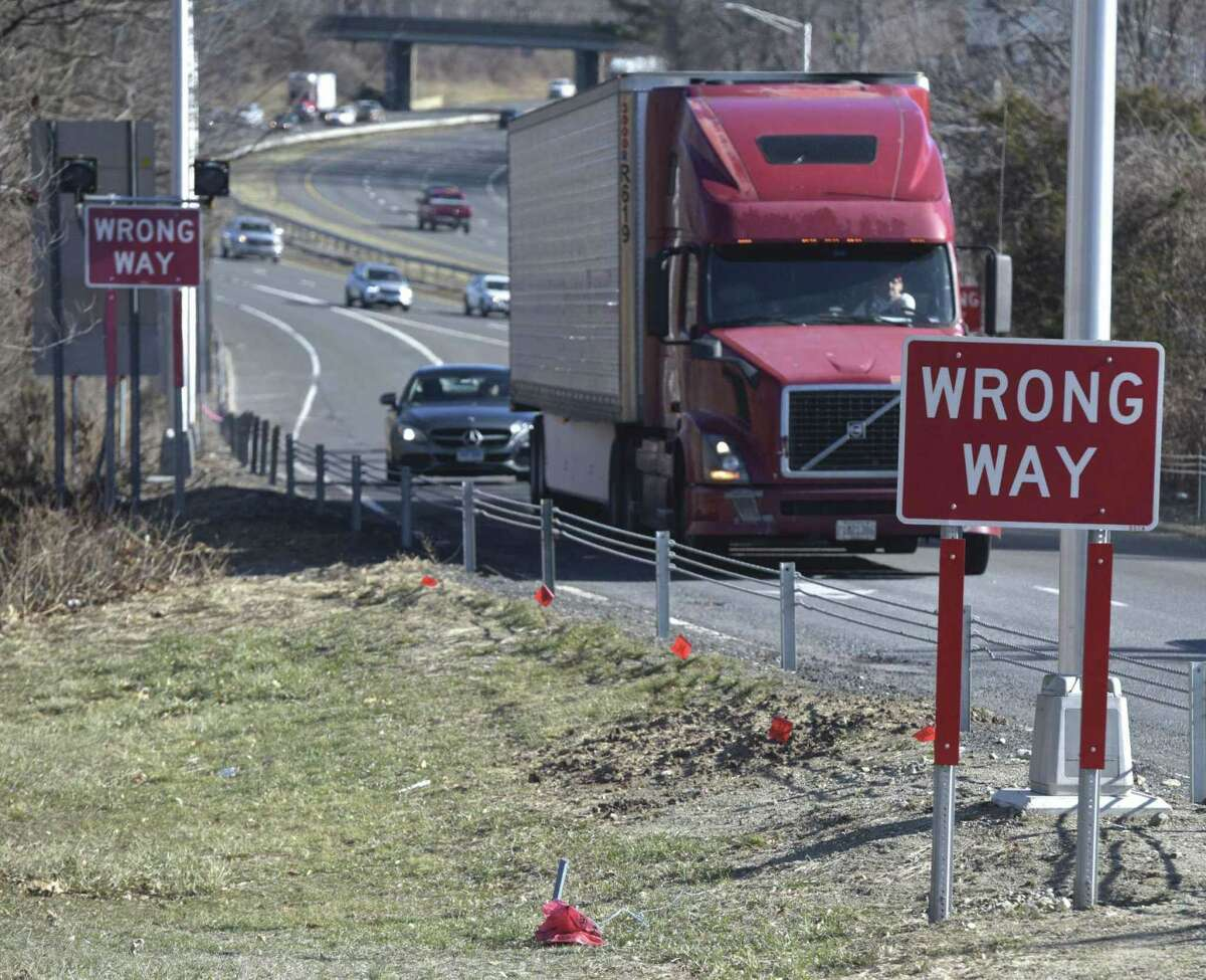 A 'wrong way' sign near the Interstate 84 westbound Exit 8 off-ramp.