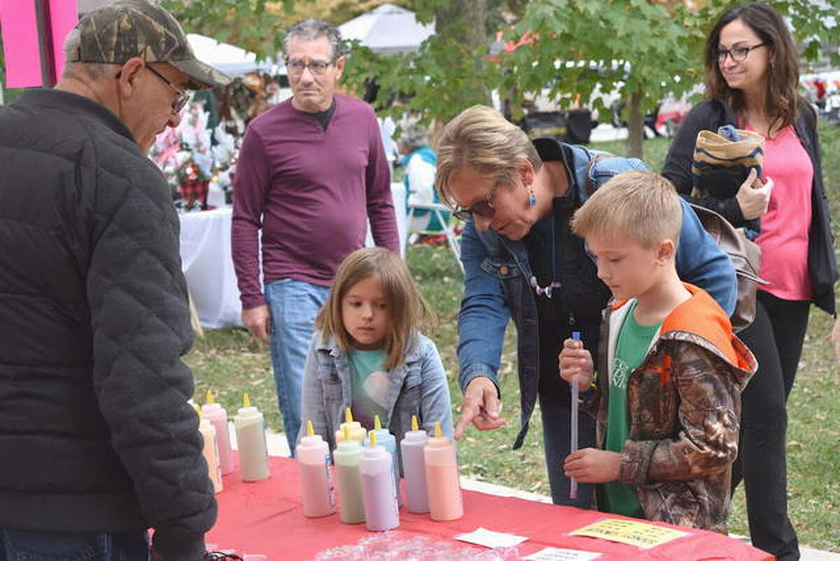 Visitors browse vendors booths at the 2019 Leclaire Parkfest in Edwardsville. Presented by the Friends of Leclaire, the event is seeking non-profit organizations and vendors for this year's event on Oct. 17.