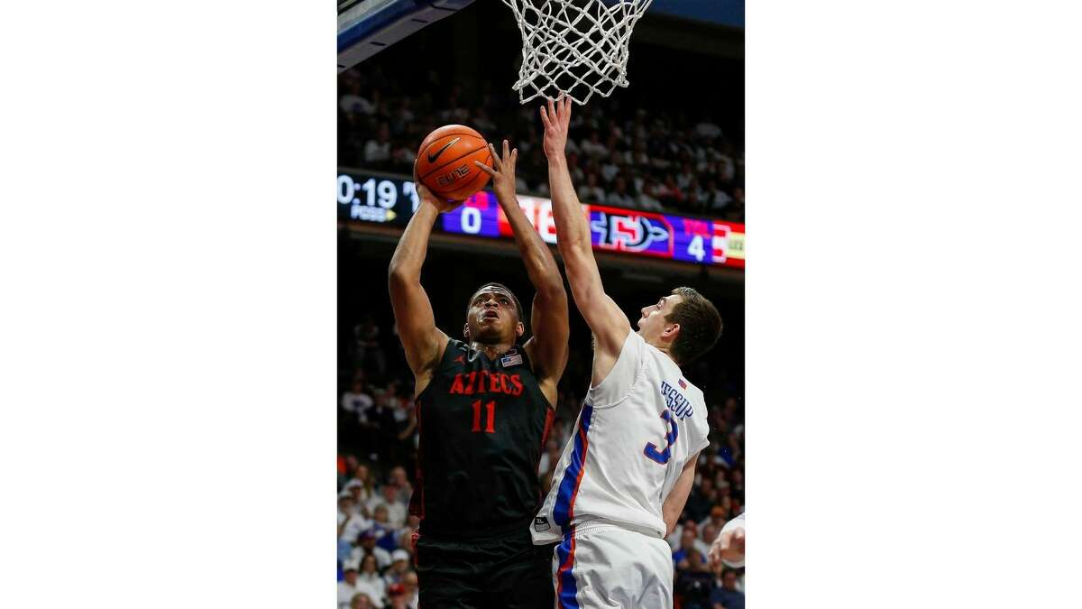 San Diego State forward Matt Mitchell (11) shoots against the defense of Boise State guard Justinian Jessup (3) during the first half of an NCAA college basketball game, Sunday, Feb. 16, 2020, in Boise, Idaho. (AP Photo/Steve Conner)