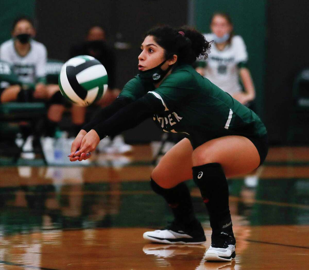 John Cooper libero Laura Weatherford (14) digs during the first set of a non-district high school volleyball match at The John Cooper School, Wednesday, Sept. 30, 2020, in The Woodlands