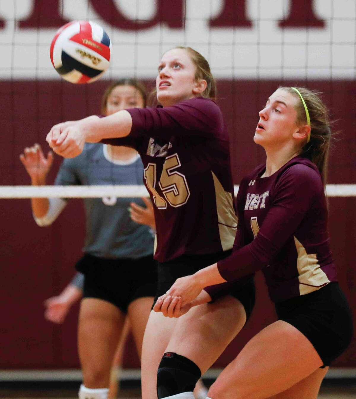 Magnolia West outside hitter Evyn Snook (15) collides with setter Bethany May (4) while returning the ball during the first set of a District 19-5A high school volleyball match at Magnolia High School, Tuesday, Oct. 6, 2020, in Magnolia.