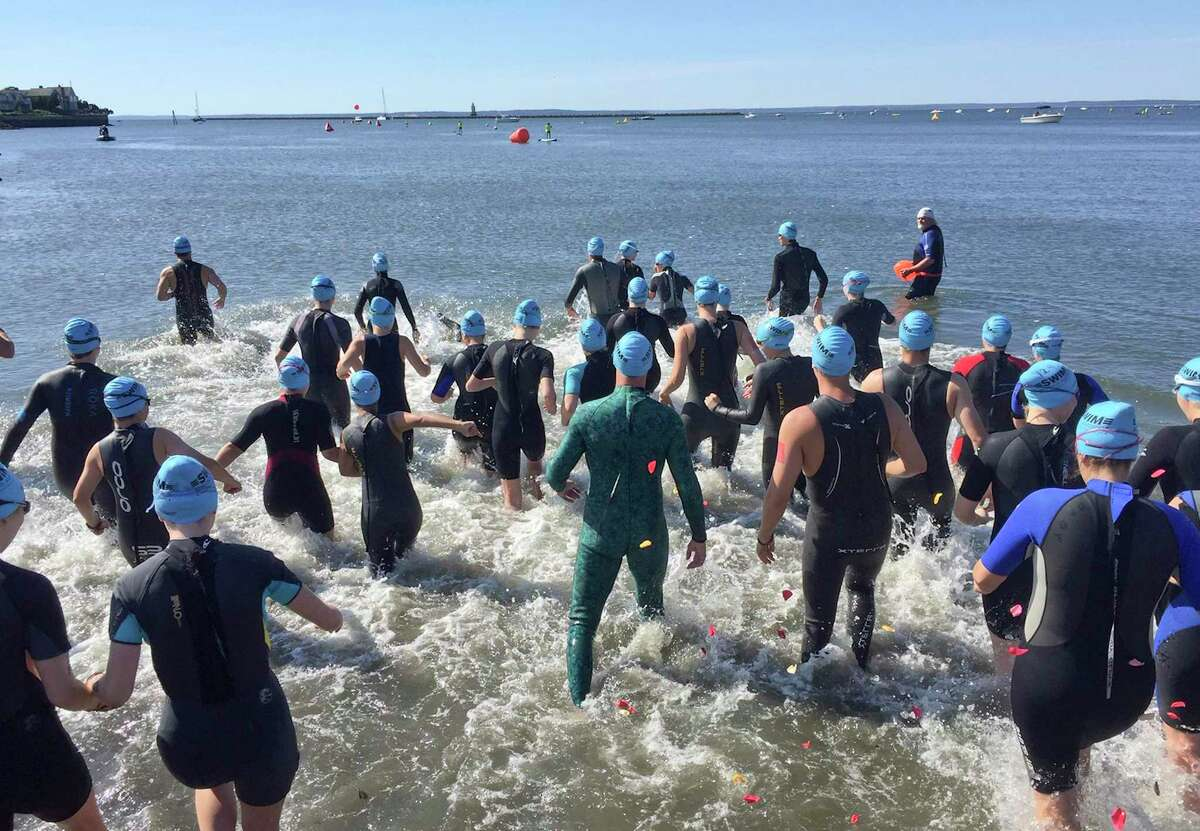Participants head to the water for the start of the 13th annual Swim Across America Fairfield County open water swim on June 22, 2019 in Stamford. Participants swam in the open waters of Long Island Sound to raise money to fight cancer.