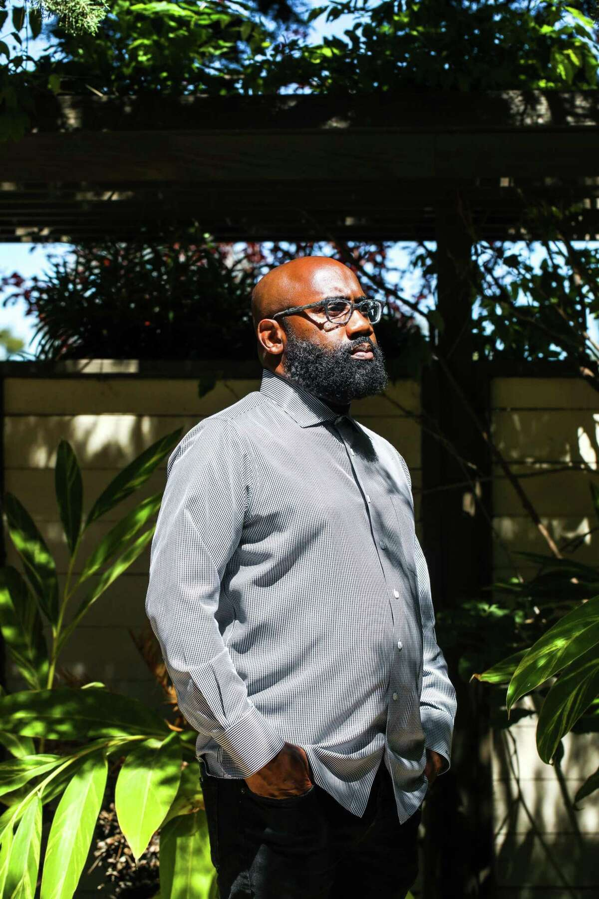 The Rev. Kaloma Smith stands in a garden at University AME Zion Church in Palo Alto. Smith, who moved to the city eight years ago, said he wasn't surprised by the recent lawsuit by five police officers who objected to depictions of Assata Shakur in a temporary Black Lives Matter mural outside City Hall.