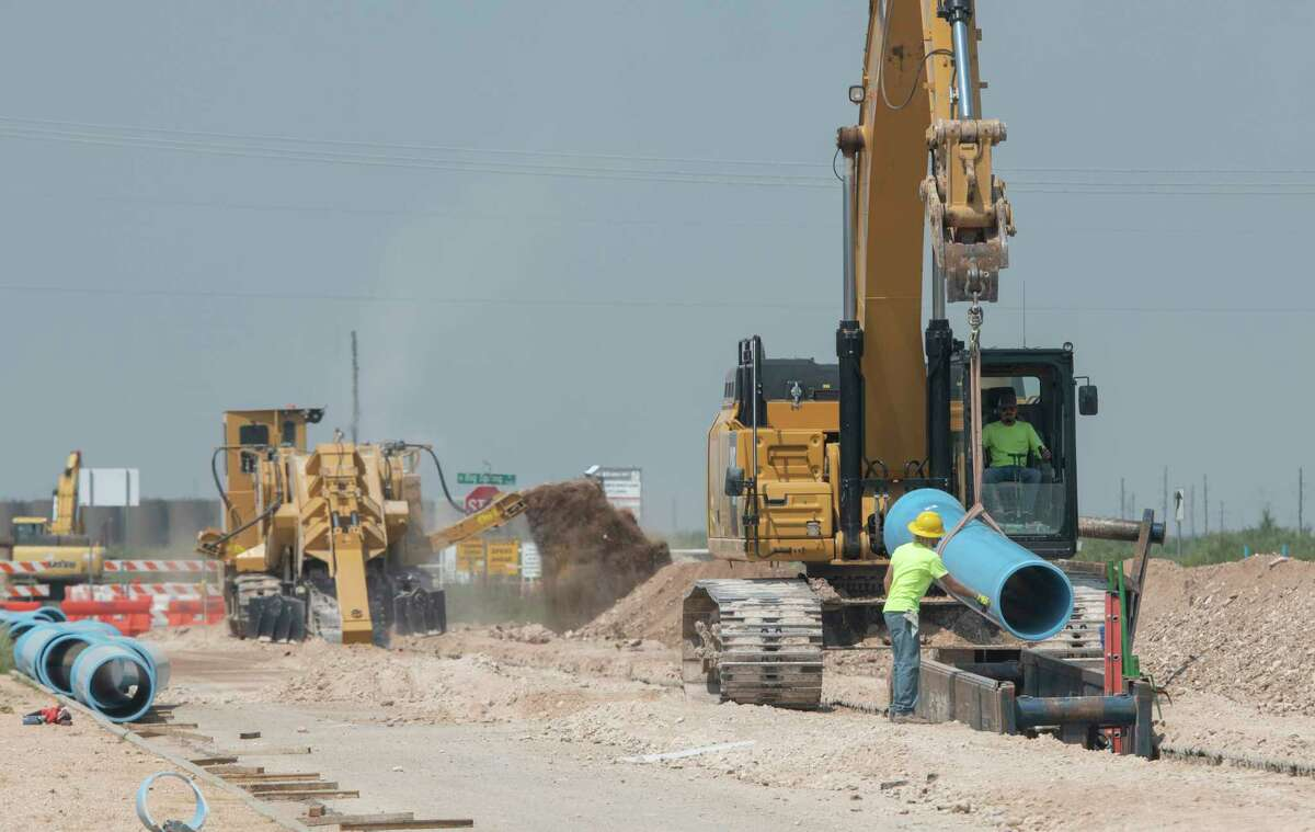 The City of Midland continues work on a new water tower off north Hwy 349, just north of Craddick Hwy 08/03/2021 and laying new water lines along Occidental Pkwy to better supply developments northeast of Midland. Tim Fischer/Reporter-Telegram