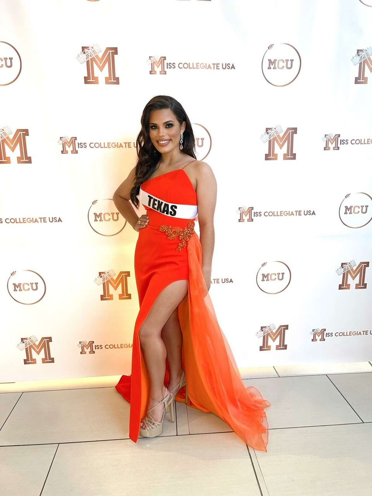 Hall poses in an evening gown during the 2021 Miss Collegiate USA pageant.