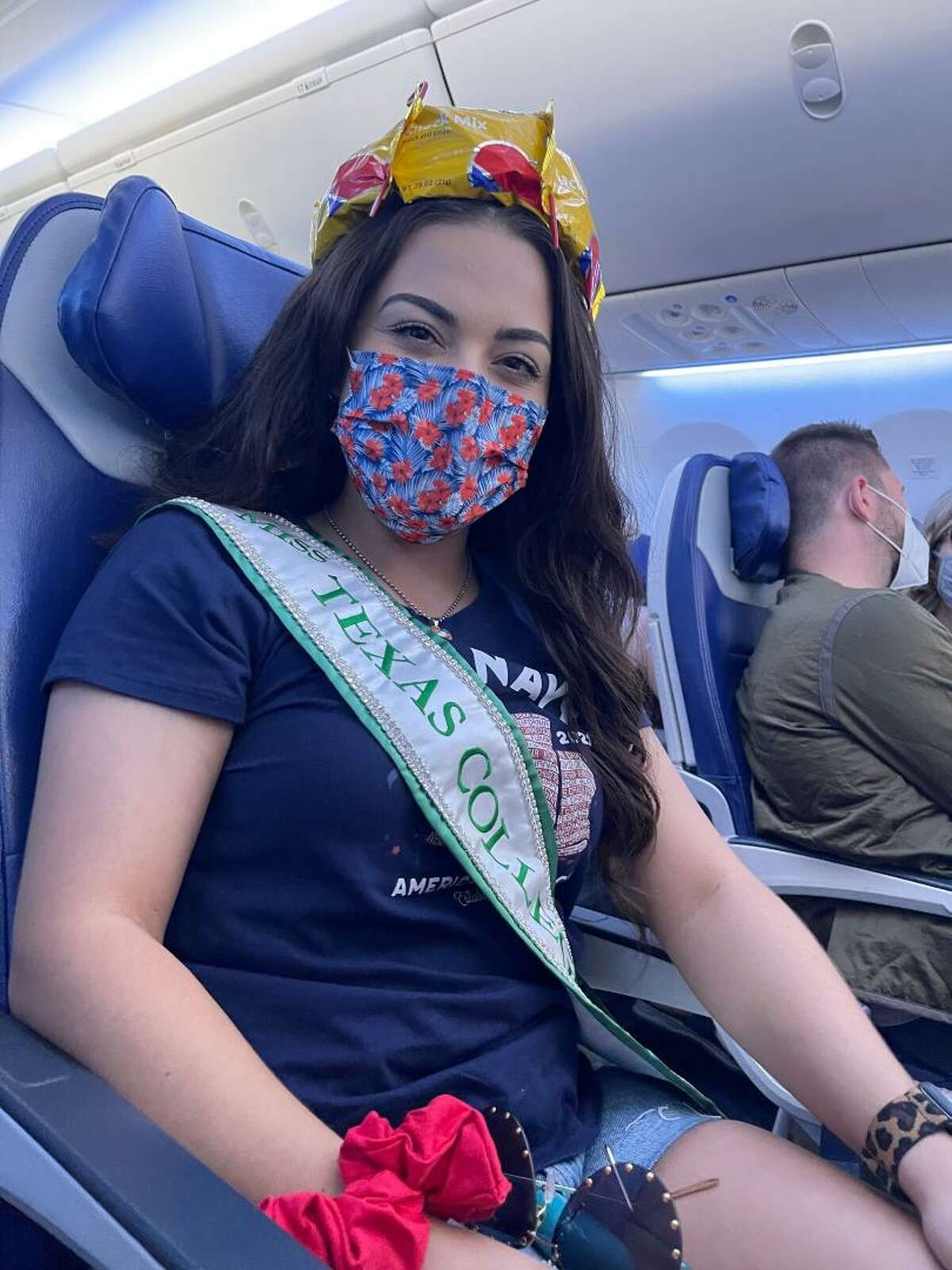 Jessica Hall of Alvin received a unique crown when Southwest Airlines flight attendants noticed that she was traveling to a national pageant with a Miss Texas Collegiate crown and sash tucked beneath her seat. The attendants fashioned an impromptu crown of their own for Hall.