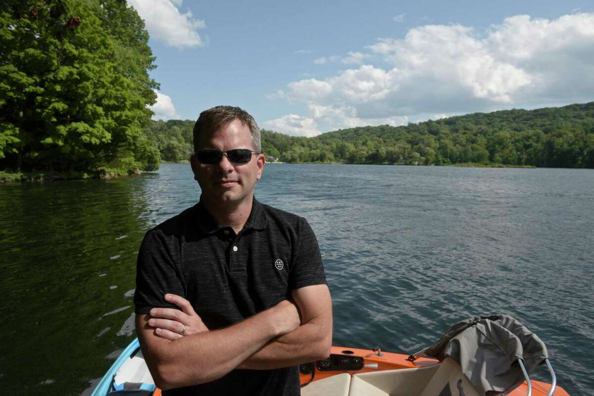 Dean Williams, president of the Mamanasco Lake Improvement Fund, stands on his dock on Mamanasco Lake. The MLIF is celebrating its 50th anniversary this year. Friday, July 30, 2021, in Ridgefield, Conn.