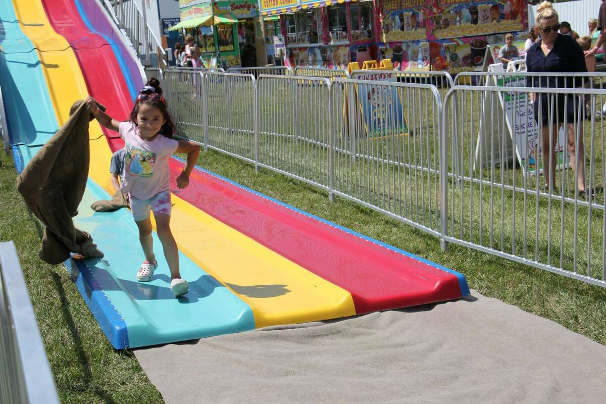 The 2021 Huron Community Fair continued on Tuesday in high spirits with the pig show, animal exhibits and the midway, which drew hundreds of families and kids to enjoy the rides.