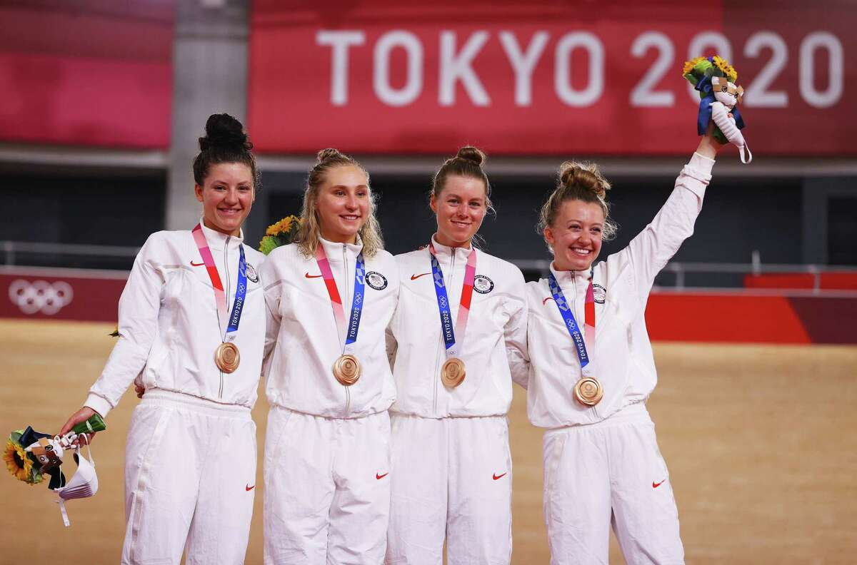 IZU, JAPAN - AUGUST 03: (L-R) Bronze medalists Chloe Dygert, Megan Jastrab, Jennifer Valente, Emma White of Team United States, pose on the podium during the medal ceremony during the Women's team pursuit finals of the Track Cycling on day eleven of the Tokyo 2020 Olympic Games at Izu Velodrome on August 03, 2021 in Izu, Japan.