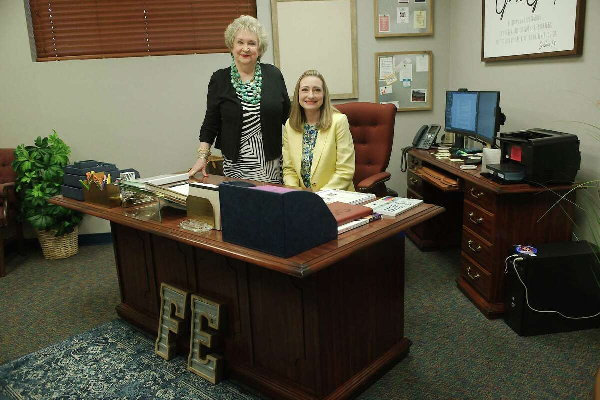 New Fairmont Elementary School Principal Melissa Fagan sits at the desk that her mother, Peaches McCroskey, left, used as the school's first principal.