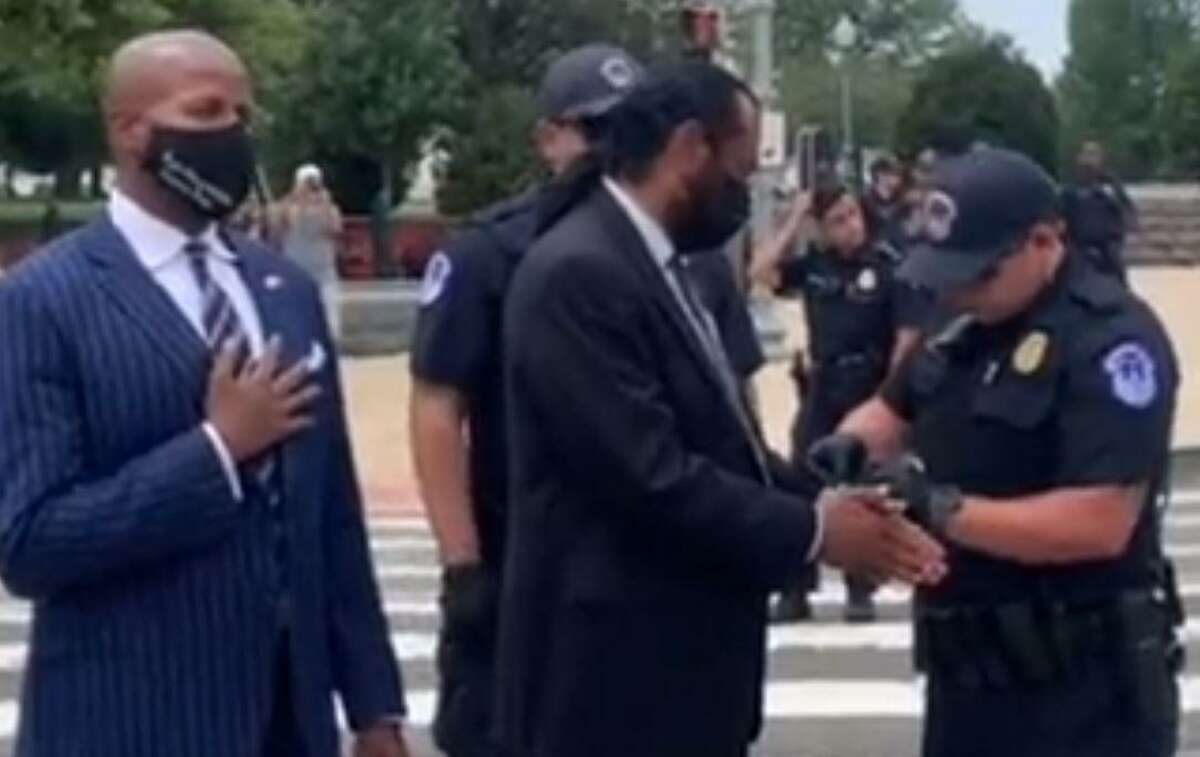 Texas Democrats U.S. Rep. Al Green of Houston and state Rep. Ron Reynolds of Missouri City are arrested as they protest in Washington, D.C., on Aug. 3, 2021.