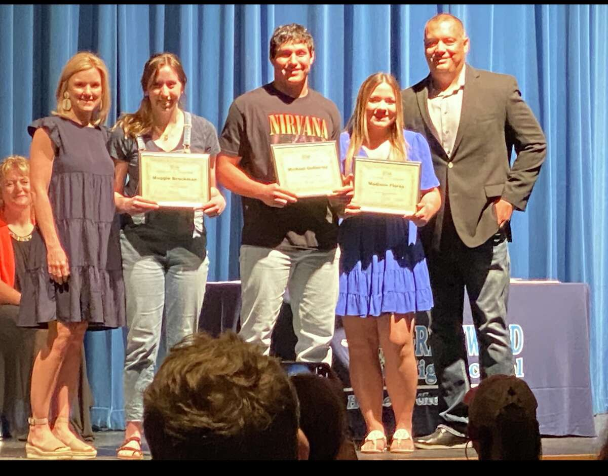 33 Lead Foundation President Joe Flores, far right, is pictured with some of last year's scholarship recipients. The foundation awarded more than $12,000 in scholarships last year to area athletes.