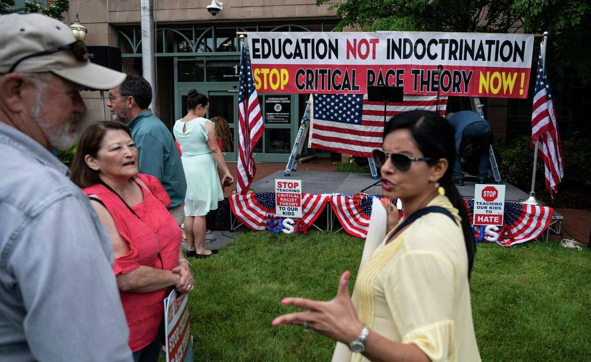People rally against the teaching of critical race theory in schools at the Loudoun County Government Center in Leesburg, Va., in June.