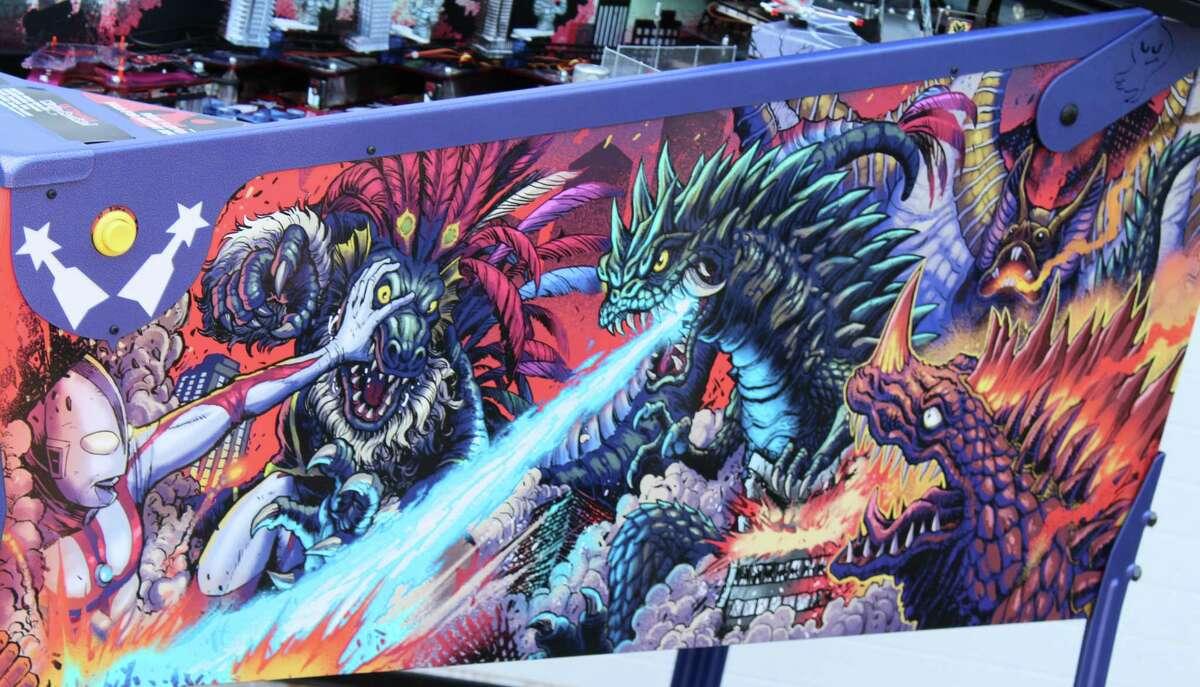 Cabinet art for the pinball game Ultraman: Kaiju Rumble! features illustrations by artist and San Antonio native Matt Frank.