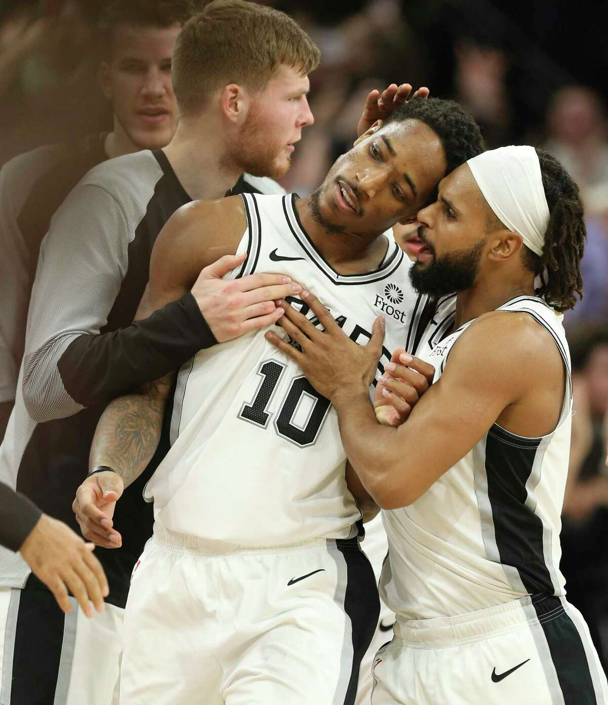 DeMar DeRozan (10) is headed to the Bulls in a sign-and-trade deal, and Patty Mills will join the Nets as a free agent.