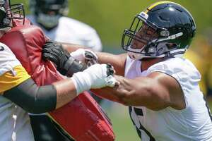 Pittsburgh Steelers offensive tackle Dan Moore Jr., right, performs a blocking drill during an NFL football practice, Thursday, July 22, 2021, in Pittsburgh. (AP Photo/Keith Srakocic)