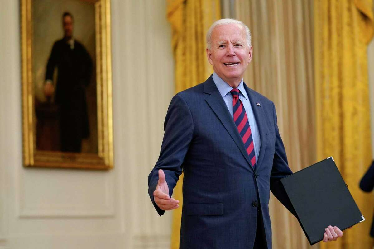 President Joe Biden turns back to answer a question after speaking about the coronavirus pandemic in the East Room of the White House in Washington, Tuesday, Aug. 3, 2021.