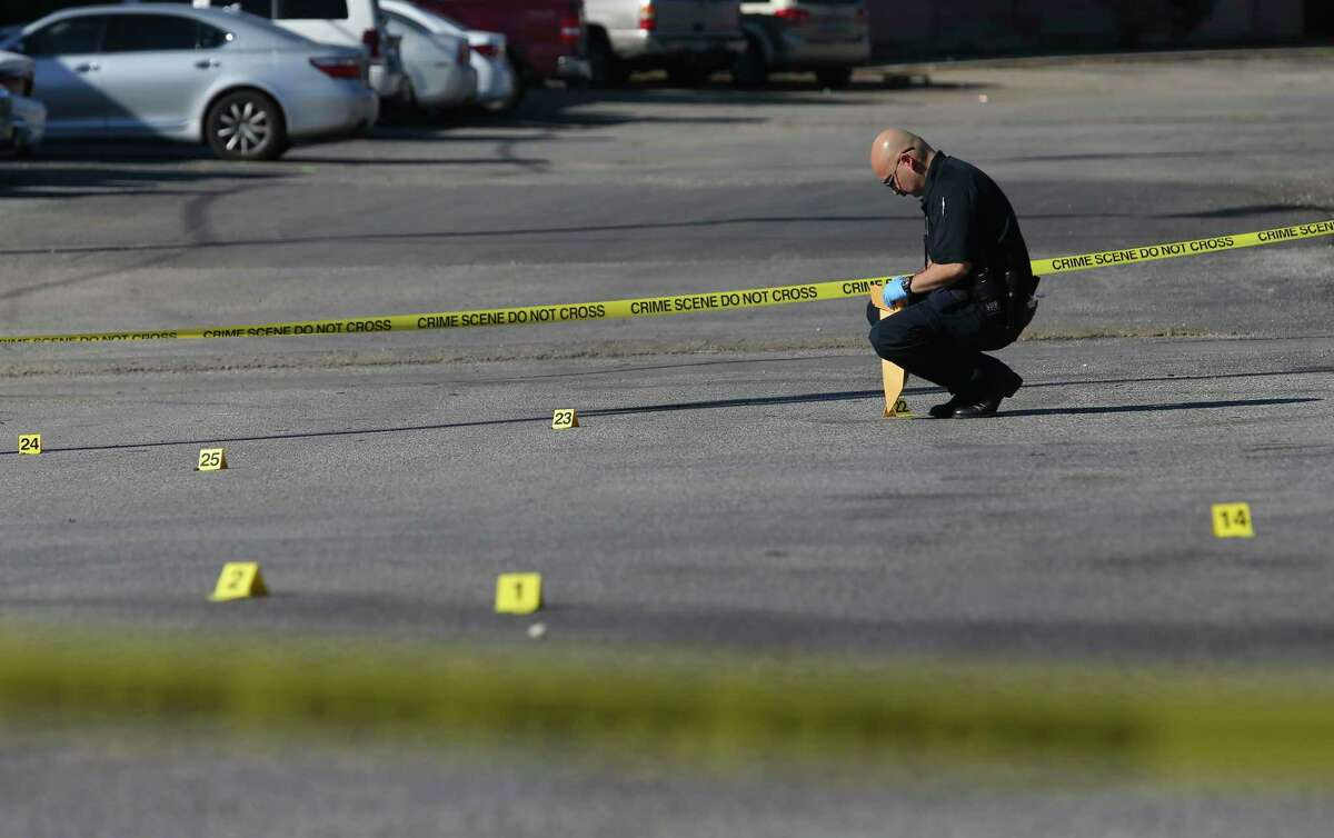 San Antonio police investigate the scene of a double shooting at the Pecan Valley Golf Club Apartments in January 2020.