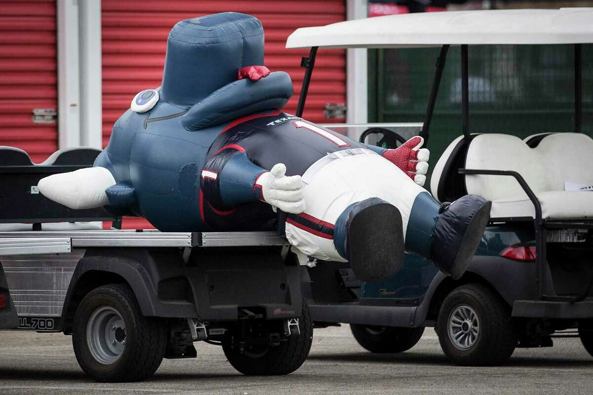 The Houston Texans mascot, inflatable Toro, lies down on a cart during an NFL training camp football practice Tuesday, Aug. 3, 2021, in Houston.