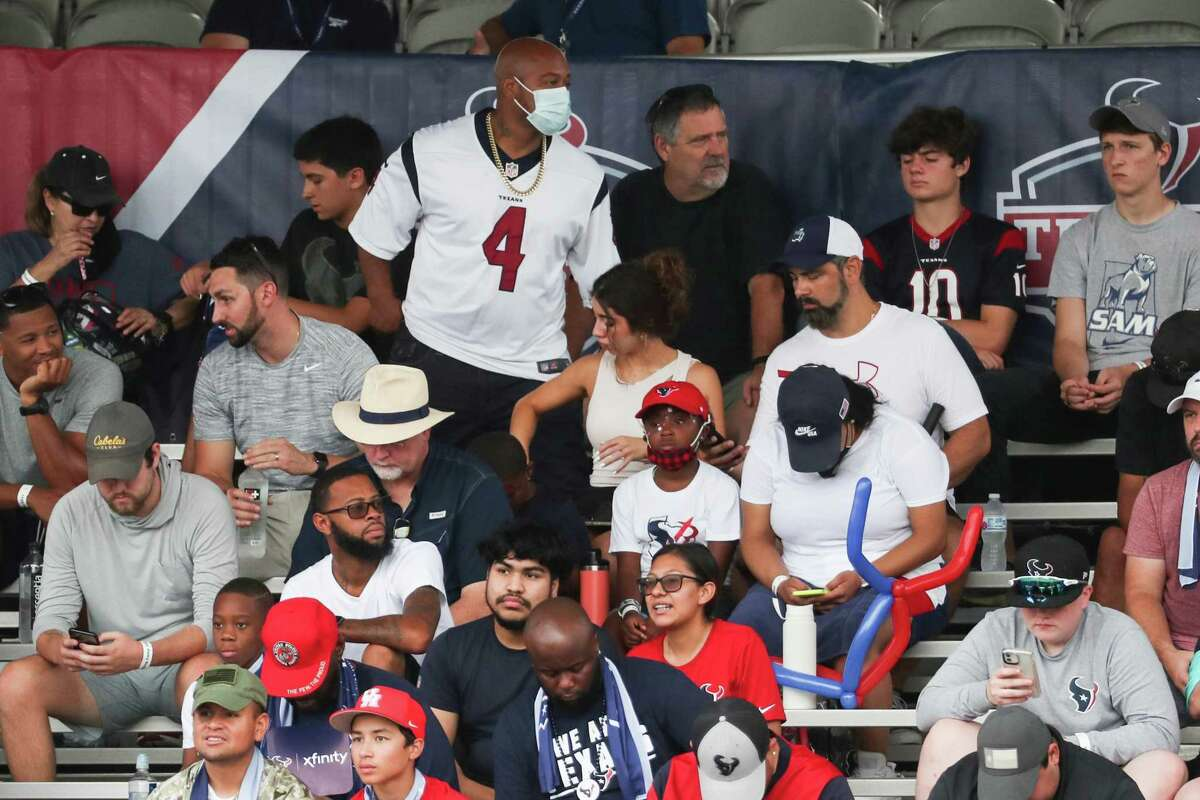 Houston Texans fans watch an NFL training camp football practice Tuesday, Aug. 3, 2021, in Houston.