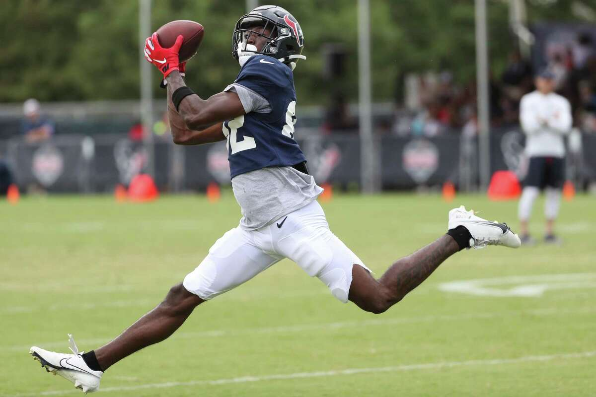 Houston Texans wide receiver Isaiah Coulter leaps to make a catch during an NFL training camp football practice Tuesday, Aug. 3, 2021, in Houston.